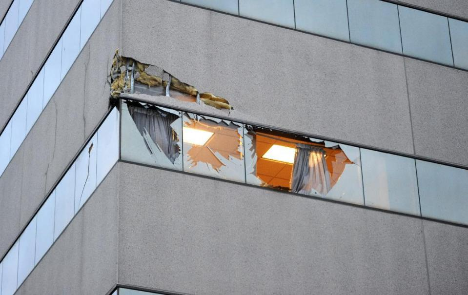 This Dec. 29, 2015 photo shows damage to the corner of The Brady Building after a small plane crashed into it in downtown Anchorage, Alaska. The pilot was not authorized to fly the aircraft used in volunteer search-and-rescue missions, authorities said. (Bob Hallinen/Alaska Dispatch News via AP) KTUU-TV OUT; KTVA-TV OUT; THE MAT-SU VALLEY FRONTIERSMAN OUT